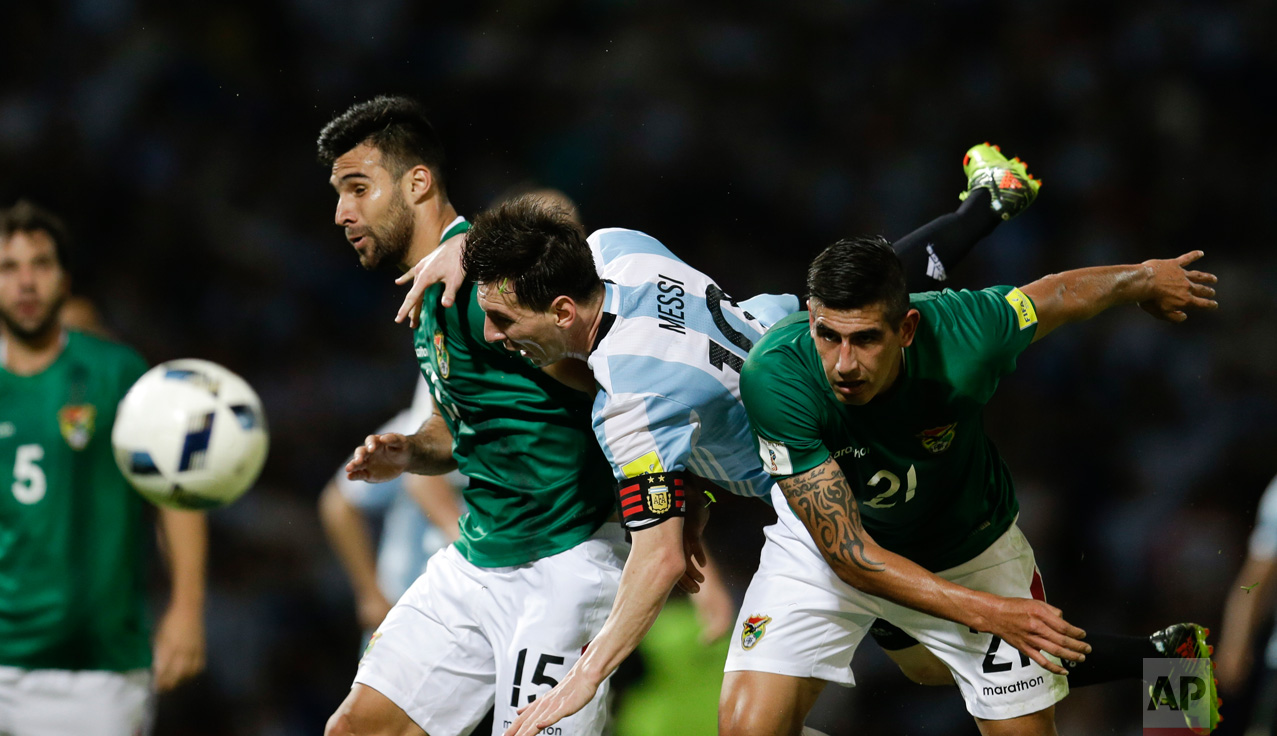 In this March 29, 2016 photo, Argentina's Lionel Messi, center, fights for the ball with Bolivia's Ronald Eguino, right, and Danny Bejarano during a 2018 World Cup qualifying soccer match in Cordoba, Argentina. (AP Photo/Natacha Pisarenko)