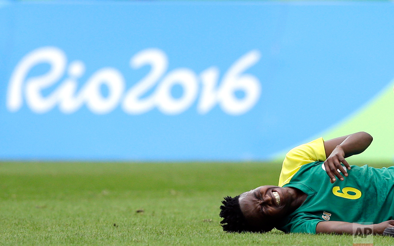 In this Aug. 3, 2016 photo, South Africa's Mamello Makhabane grimaces in pain after being fouled during the opening match of the women's Olympic football tournament between Sweden and South Africa at the Rio Olympic Stadium in Rio de Janeiro, Brazil. (AP Photo/Leo Correa, file)