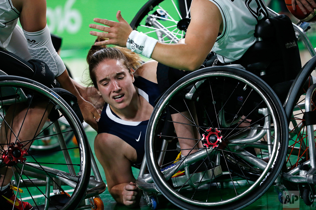 In this Sept. 16, 2016 photo, United States' Rebecca Murray falls during a women's gold medal wheelchair basketball game against Germany at the Paralympic Games in Rio de Janeiro, Brazil. United States won the gold. (AP Photo/Silvia Izquierdo)