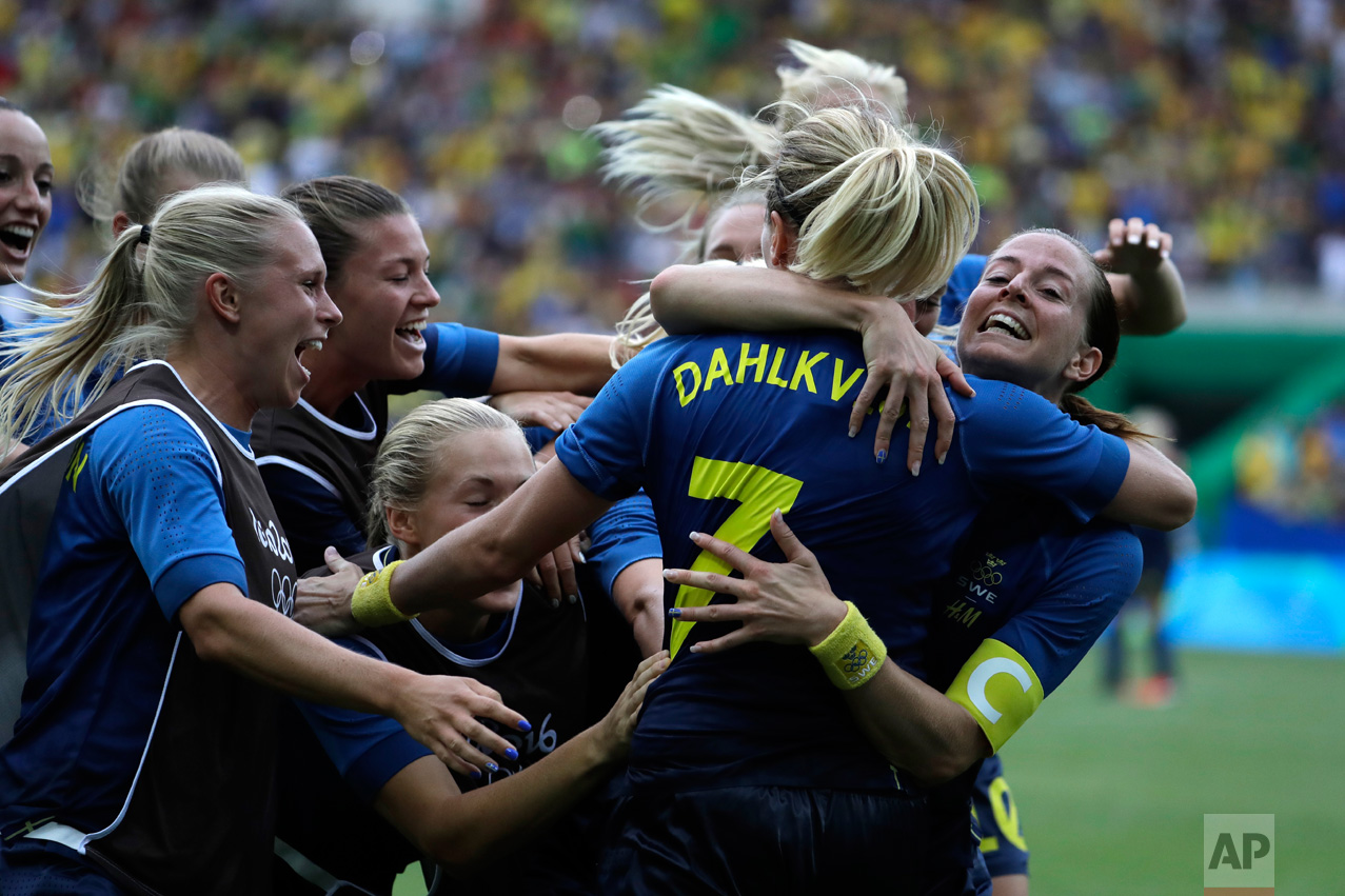In this Aug. 16, 2016 photo, Sweden's players celebrate after the penalty kicks during a semi-final match of the women's Olympic football tournament between Brazil and Sweden at the Maracana Stadium in Rio de Janeiro. Sweden qualified for the final after beating Brazil on a penalty shoot-out. (AP Photo/Natacha Pisarenko)