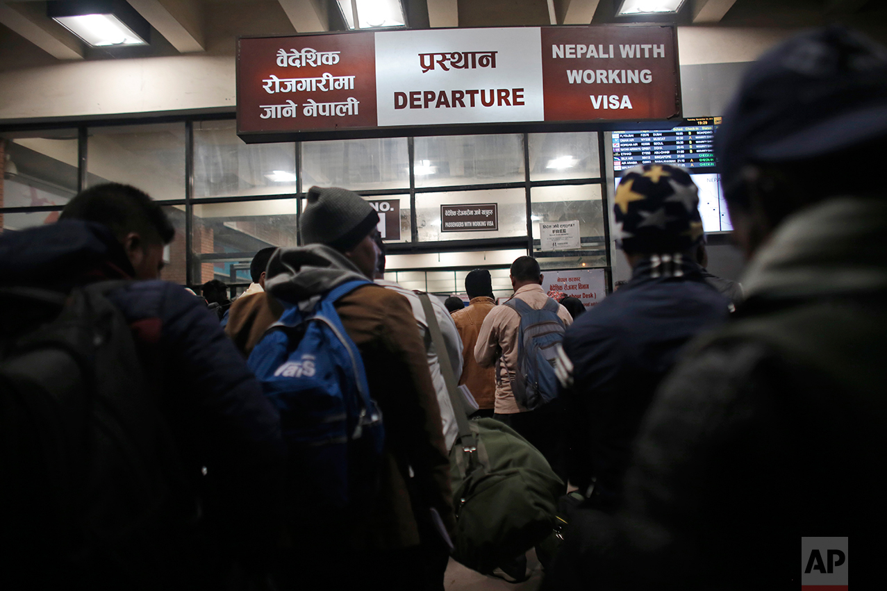 In this Tuesday, Nov. 22, 2016 photo, Nepali workers stand in queues at the departure gate for migrant workers at Tribhuwan International Airport in Kathmandu, Nepal. About 10 percent of Nepal's 28 million residents are working abroad. They send back more than $6 billion a year, amounting to about 30 percent of the country's annual revenues. Only Tajikistan and Kyrgyzstan are more dependent on foreign earnings. (AP Photo/Niranjan Shrestha)