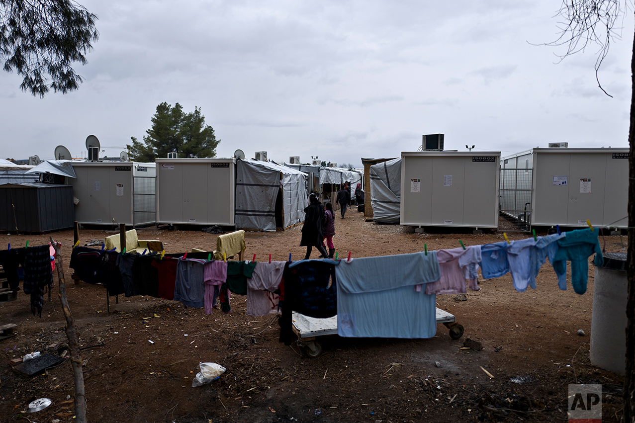 The laundry of a Syrian refugee family is hung out to dry near their shelter at the refugee camp of Ritsona about 86 kilometers (53 miles) north of Athens, Wednesday, Dec. 28, 2016. (AP Photo/Muhammed Muheisen)
