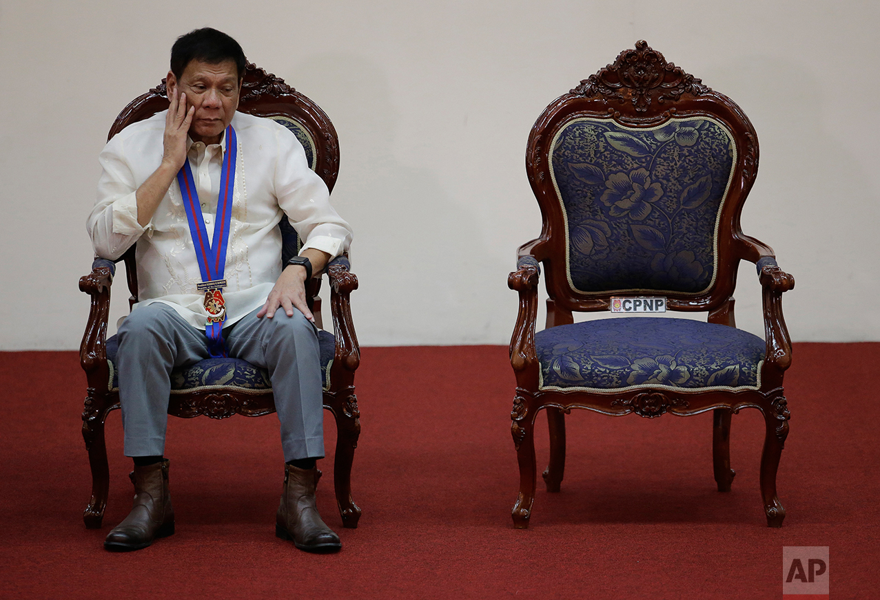"Philippine President Rodrigo Duterte listens during the ""Assumption of Command"" of new Police Chief, Director General Ronald Dela Rosa at Camp Crame, Philippine National Police headquarters, in suburban Quezon city, Manila, Philippines on Friday, July 1, 2016. (AP Photo/Aaron Favila)"