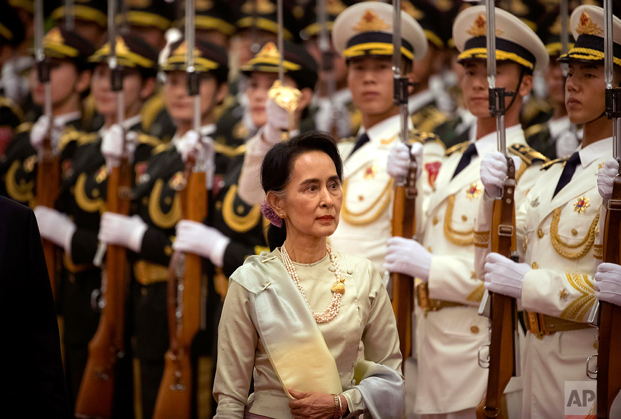 Myanmar's State Counselor Aung San Suu Kyi reviews an honor guard during a welcome ceremony at the Great Hall of the People in Beijing, Thursday, Aug. 18, 2016. (AP Photo/Mark Schiefelbein)