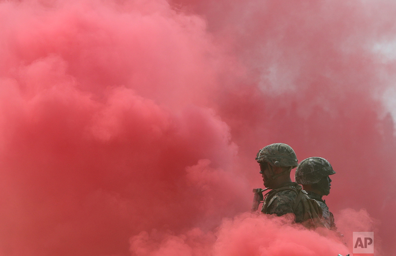 In this Friday, Sept. 9, 2016, photo, South Korean and U.S. Marines stand in smoke during the 66th Incheon Landing Operations Commemoration ceremony in Incheon, South Korea. (AP Photo/Lee Jin-man)