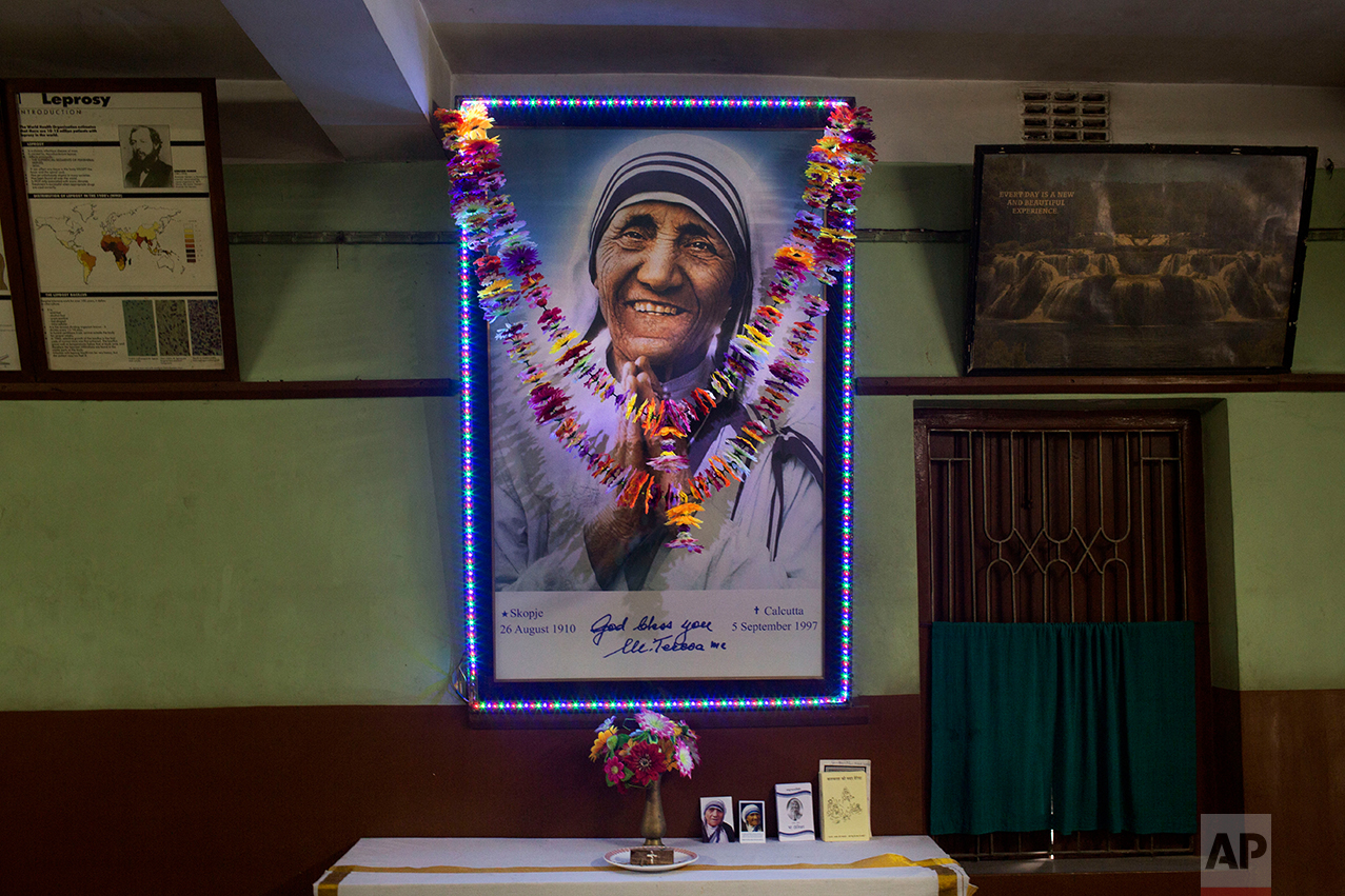 Paper flowers hang over a picture of late Mother Teresa inside Gandhiji Prem Nivas, a Leprosy centre conducted by Missionaries of Charity in Titagarh, north of Kolkata, India, Saturday, Sept. 3, 2016.  (AP Photo/Bernat Armangue)