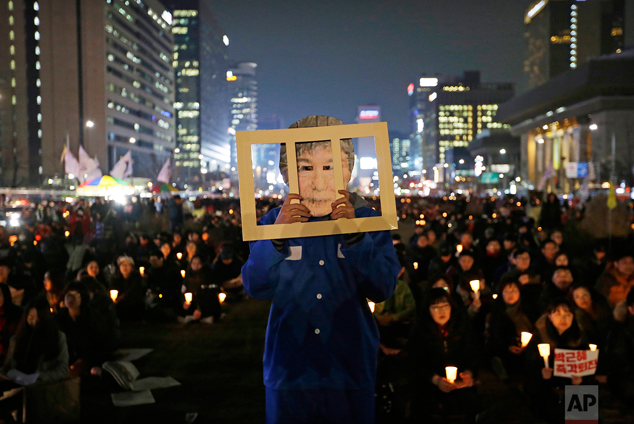 In this Wednesday, Nov. 30, 2016 photo, a protester wearing a mask of South Korean President Park Geun-hye performs during a rally calling for Park to step down in Seoul, South Korea. (AP Photo/Ahn Young-joon)