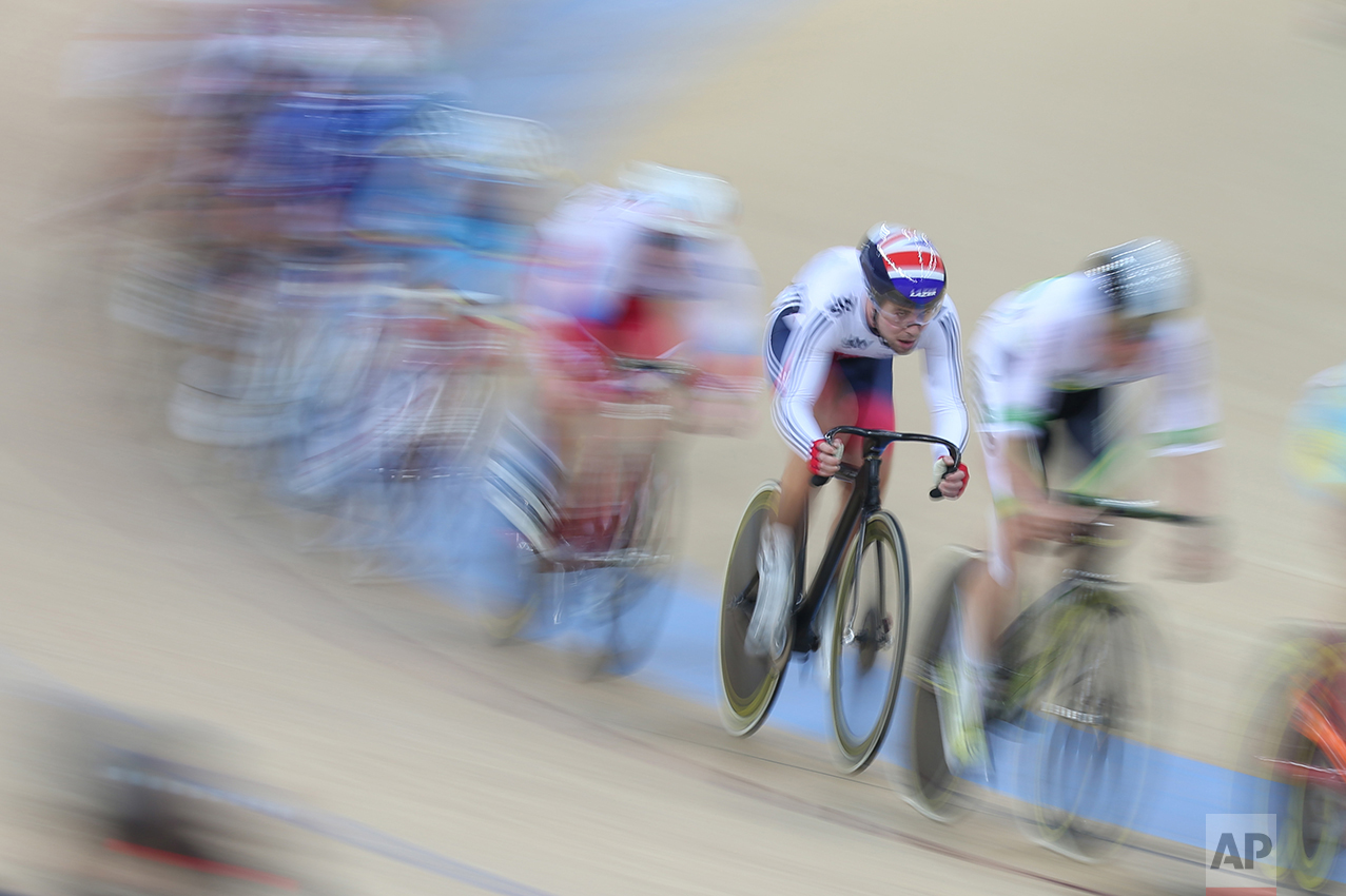 Mark Cavendish of Great Britain, second right, competes at the Men's omnium final during the UCI Track Cycling World Cup in Hong Kong, Sunday, Jan. 17, 2016. (AP Photo/Kin Cheung)