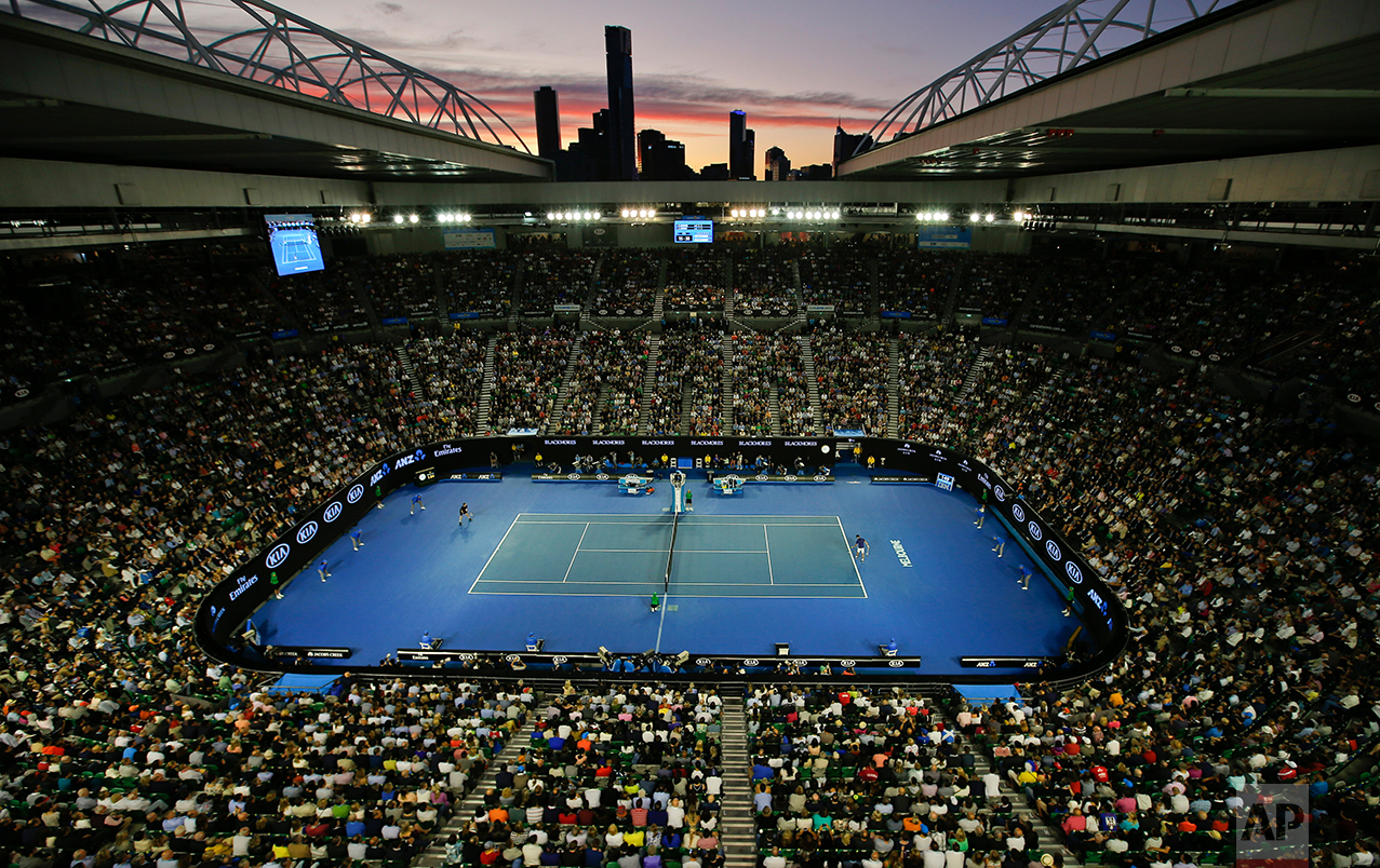 The sun sets over Rod Laver Arena during the men's singles final between Novak Djokovic of Serbia and Andy Murray of Britain at the Australian Open tennis championships in Melbourne, Australia, Jan. 31, 2016.(AP Photo/Vincent Thian)