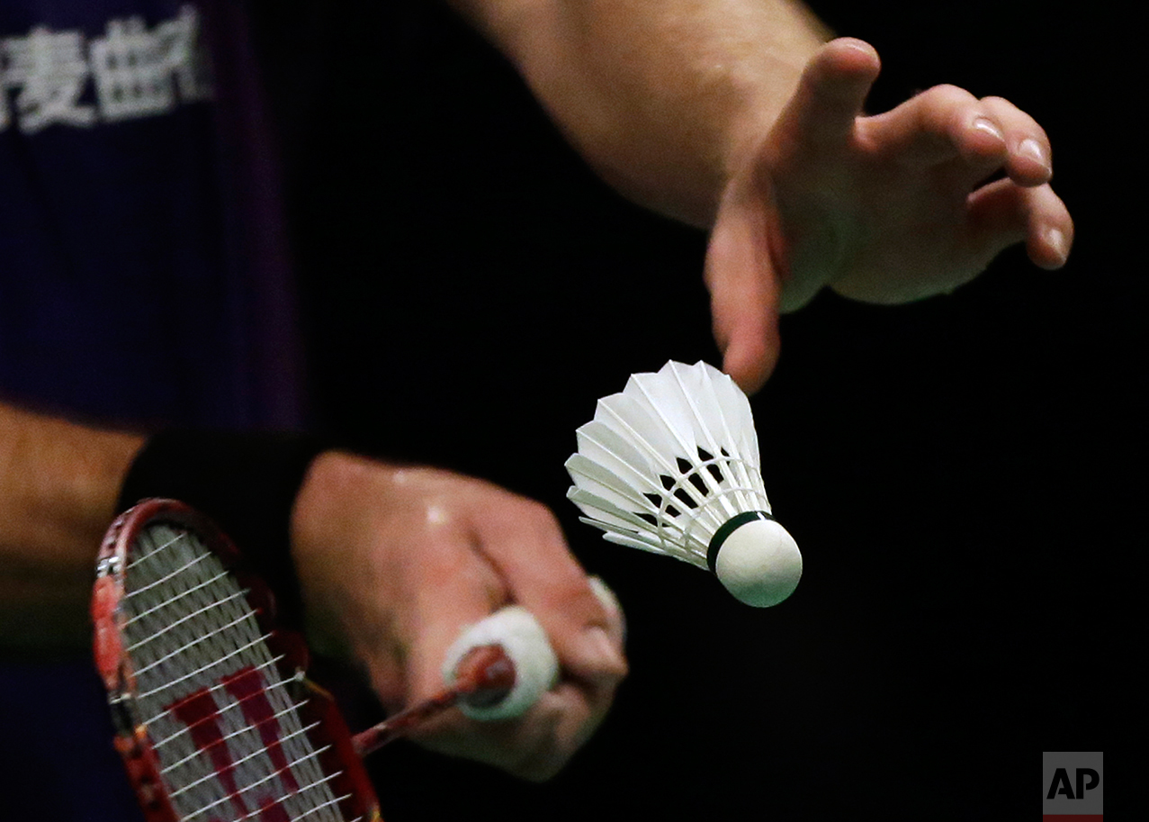 Jan O Jorgensen of Denmark serves against China's Tian Houwei during their men's singles semifinal match at the Indonesia Open badminton tournament at Istora Stadium in Jakarta, Indonesia, Saturday, June 4, 2016. (AP Photo/Dita Alangkara)
