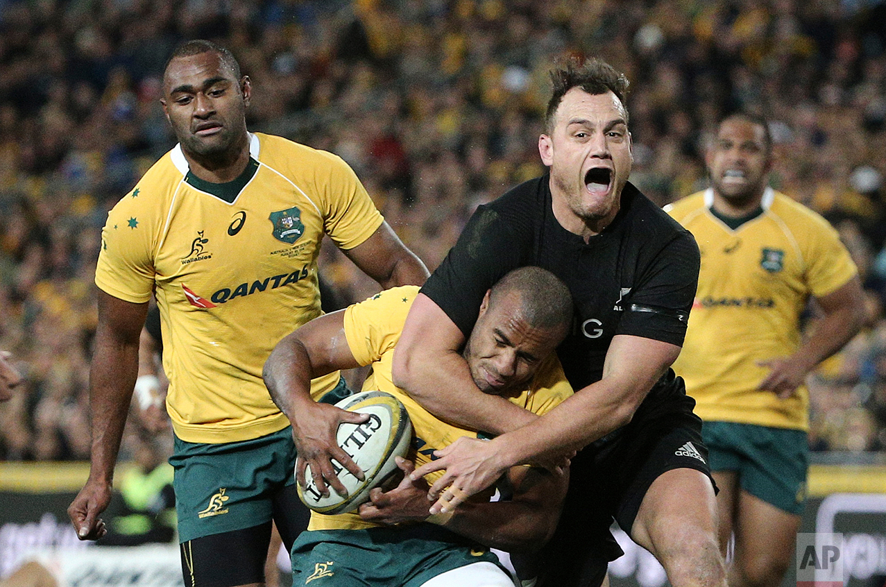 New Zealand's Israel Dagg center back, tackles Australia's Will Genia during their Bledisloe Cup Rugby test match in Sydney, Australia, Saturday, Aug. 20, 2016.(AP Photo/Rob Griffith)