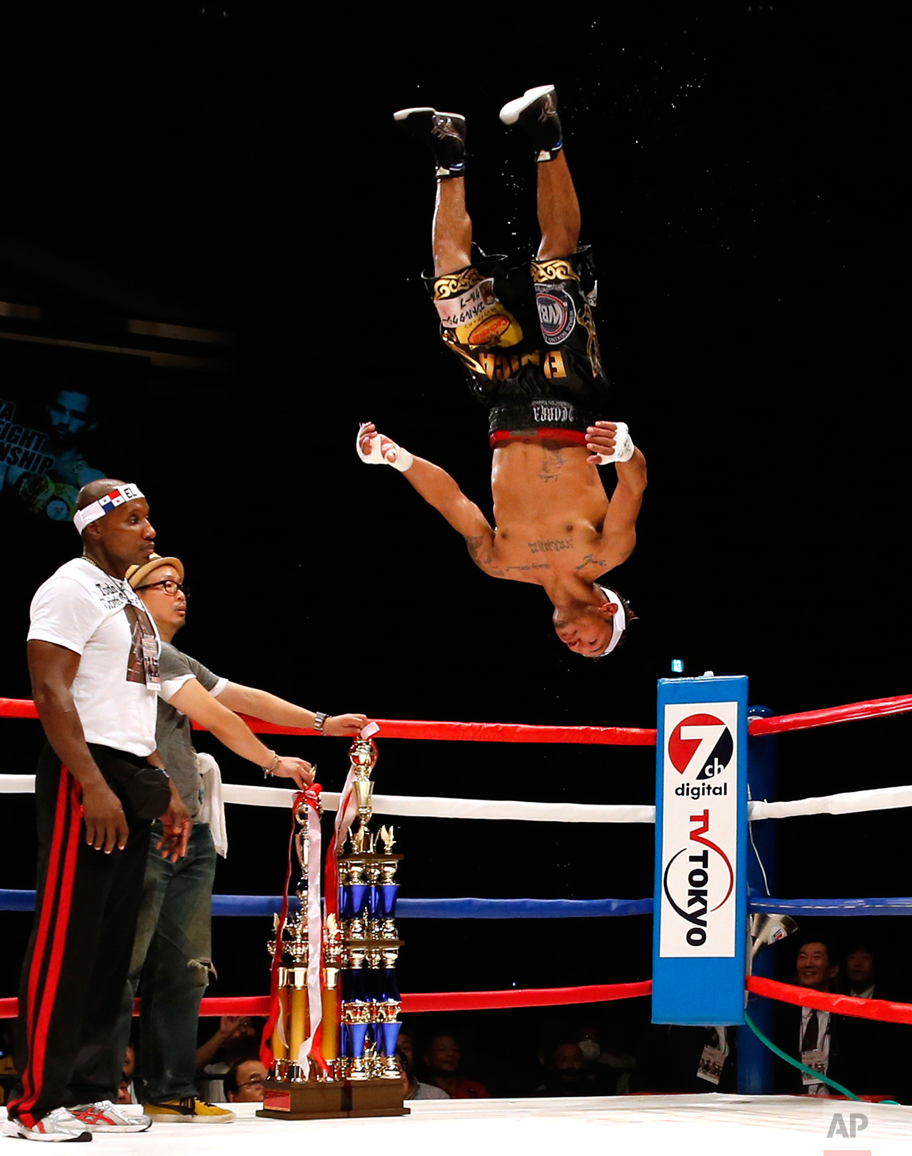 Panama's Luis Concepcion celebrates in the air after beating Japan's Kohei Kono at their WBA world super flyweight title bout in Tokyo, Wednesday, Aug. 31, 2016. Concepcion won the title by a unanimous decision. (AP Photo/Toru Takahashi)