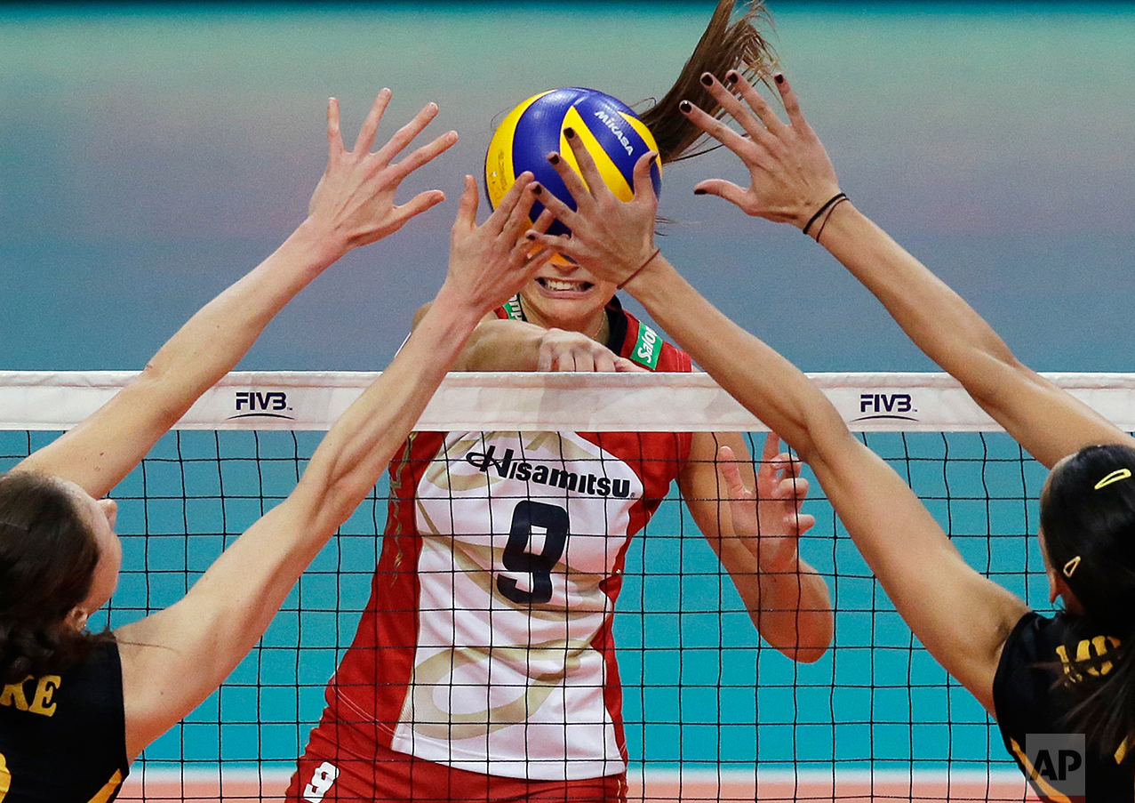 VafikBank Istanbul team players Lonneke Sloetjes from Netherlands, left, and Milena Rasic from Serbia, block the shot of Hisamitsu Springs Kobe team player Maja Tokarska from Poland during the FIVB Women's Club World Championship 2016 in Pasay, south of Manila, Philippines on Tuesday, Oct. 18, 2016. VafikBank Istanbul team won the match 3-1. (AP Photo/Aaron Favila)