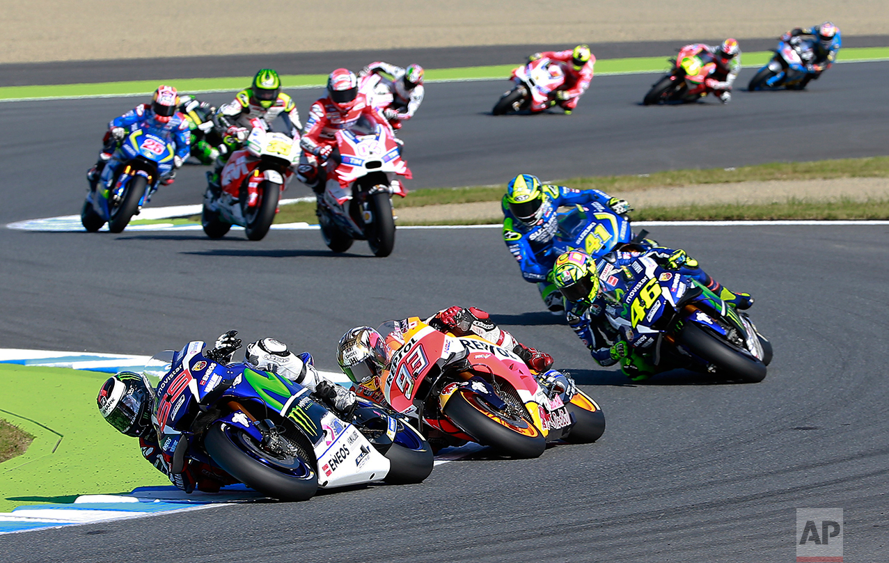Spain's Jorge Lorenzo steering his Yamaha leads the pack of riders at the MotoGP Japanese Motorcycle Grand Prix at the Twin Ring Motegi circuit in Motegi, north of Tokyo, Sunday, Oct. 16, 2016. (AP Photo/Shizuo Kambayashi)