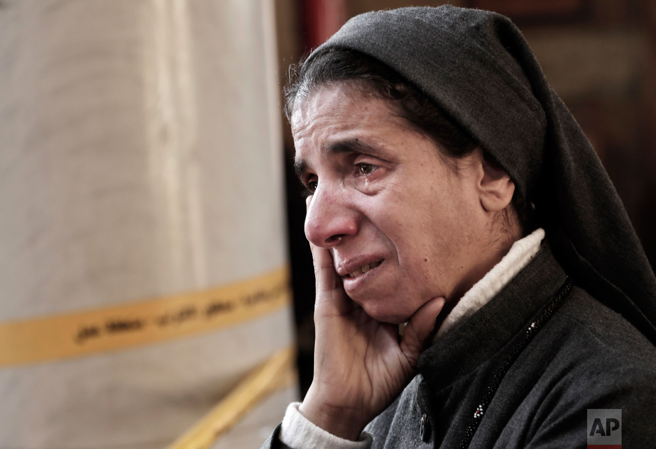 An Egyptian Coptic nun weeps as she looks at damages inside the St. Mark Cathedral in central Cairo, following a bombing, Sunday, Dec. 11, 2016. The blast at Egypt's main Coptic Christian cathedral killed dozens of people and wounded many others, according to Egyptian state television, making it one of the deadliest attacks carried out against the religious minority in recent memory. (AP Photo/Nariman El-Mofty)