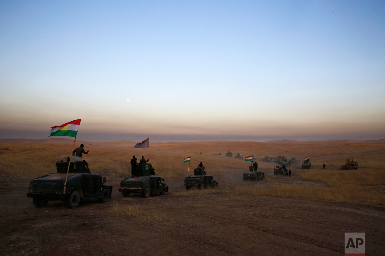 A Peshmerga convoy drives towards a frontline in Khazer, about 30 kilometers (19 miles) east of Mosul, Iraq, Monday, Oct. 17, 2016. (AP Photo/Bram Janssen)