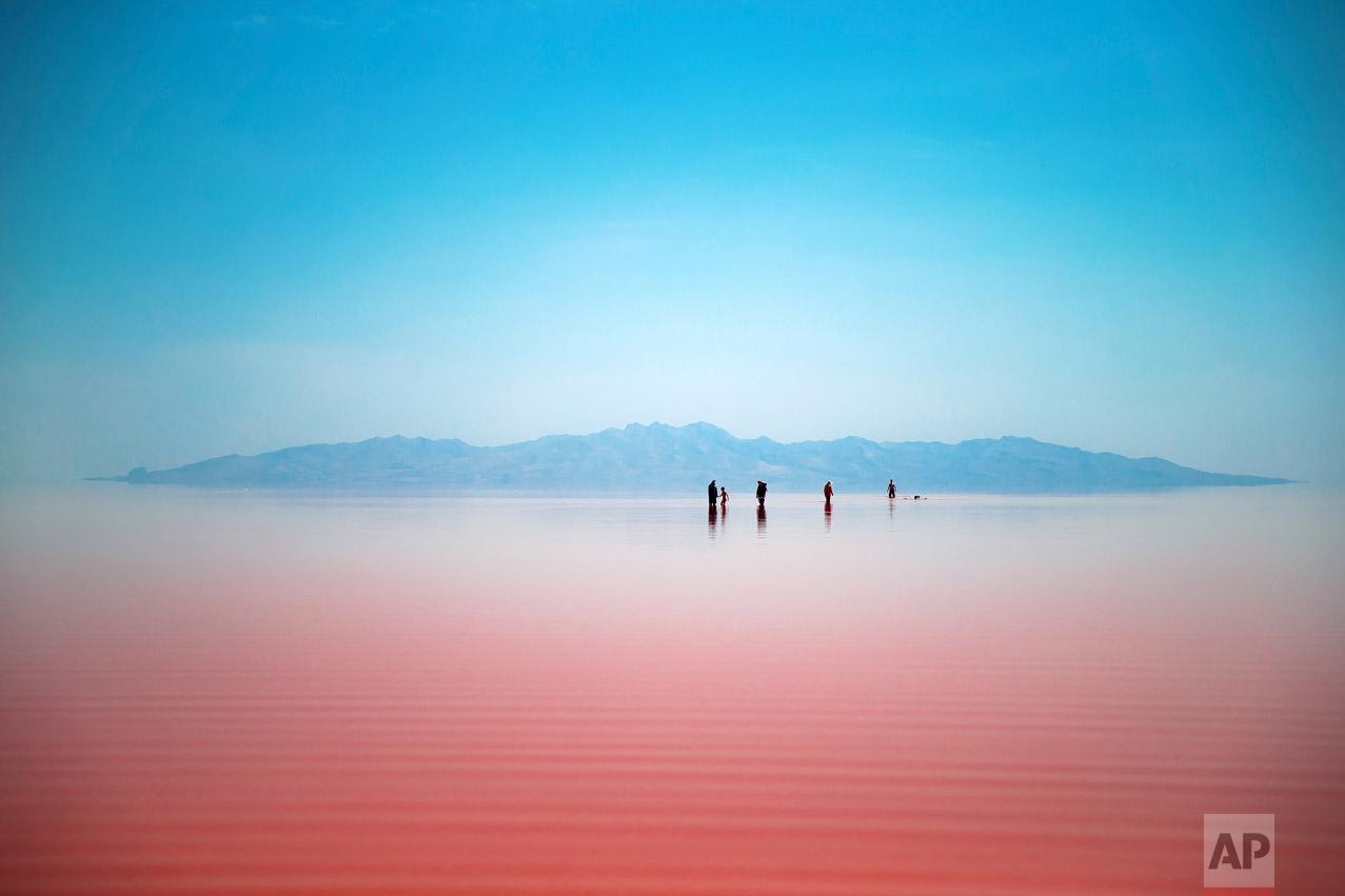 Iranians spend time in Urmia Lake near Urmia, North-western Iran, Friday, Aug. 26, 2016. (AP Photo/Ebrahim Noroozi)