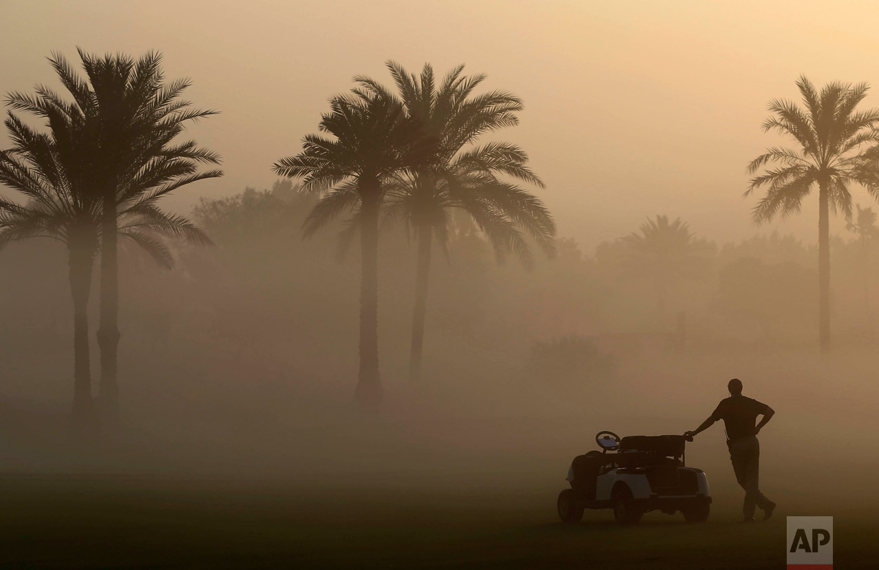 A martial looks through the early morning fog which delayed the 1st round of Dubai Ladies Masters golf tournament in Dubai, United Arab Emirates, Wednesday, Dec. 7, 2016. (AP Photo/Kamran Jebreili)