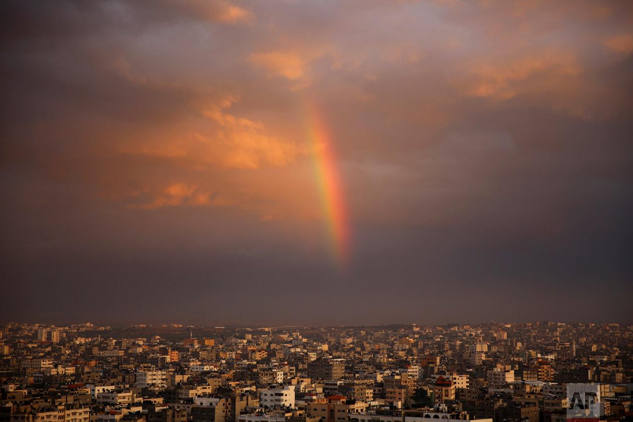 A rainbow shines in the sky above the city following a rainstorm, in Beit Lahiya City, Gaza Strip, Thursday, Dec. 8, 2016. (AP Photo/Adel Hana)