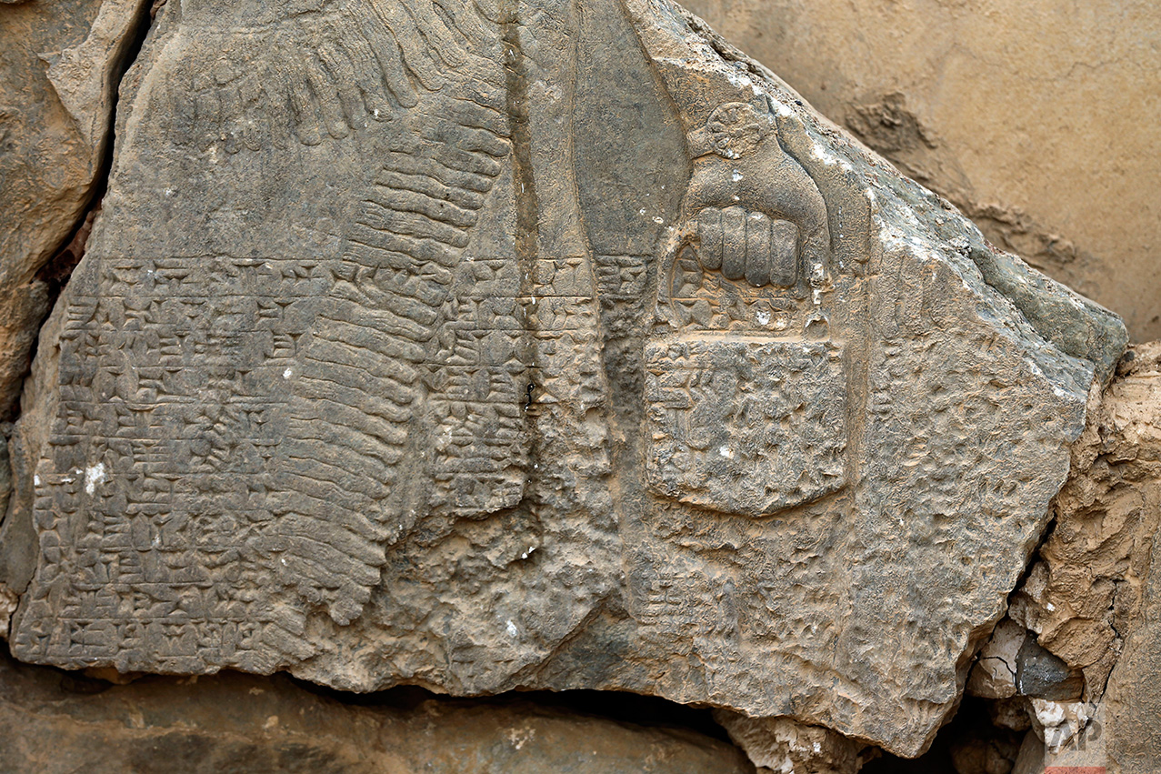 This Wednesday, Nov. 16, 2016 photo shows a part of carved stone slabs which were destroyed by Islamic State group militants, at the ancient site of Nimrud some 19 miles (30 kilometers) southeast of Mosul, Iraq. One of the Mideast's most important archaeological sites, the nearly 3,000-year-old remains of an Assyrian capital had been a trove of ancient Mesopotamian art and, with hundreds of clay tablets, provided archaeologists a wealth of information on the era. (AP Photo/Hussein Malla)