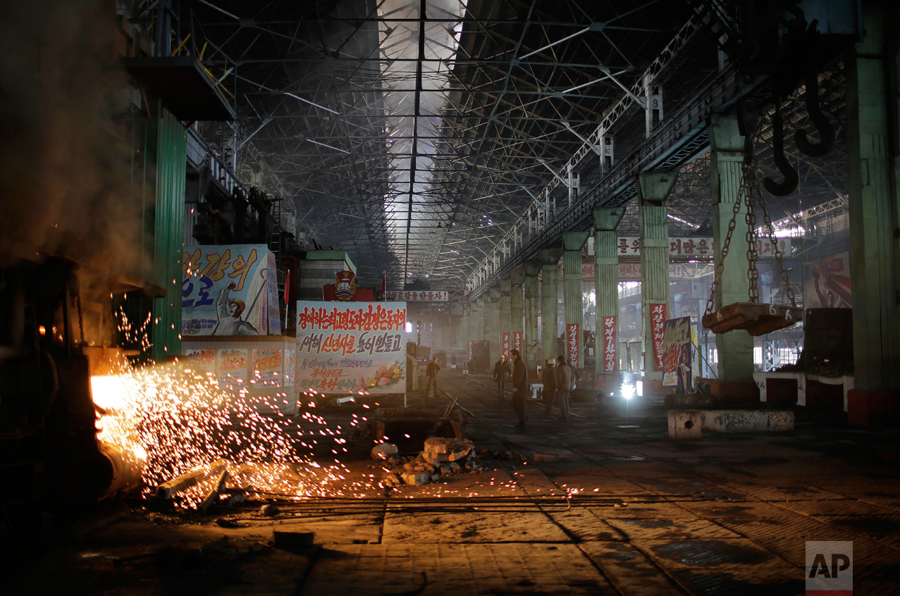 In this Saturday, Jan. 7, 2017 photo, a shaft of light from a furnace shines through the Chollima Steel Complex in Nampo, North Korea. North Korean officials and factory managers are scrambling to answer a call from leader Kim Jong Un for an all-out, nationwide effort to build up the country's economy in 2017. The sprawling Chollima complex south of Pyongyang, the capital, is a focal point of North Korea's effort to expand the economy and lift the nation's standard of living. One of seven North Korean steel works, Chollima has more than 8,000 workers and is among the North's showcase enterprises. (AP Photo/Wong Maye-E)