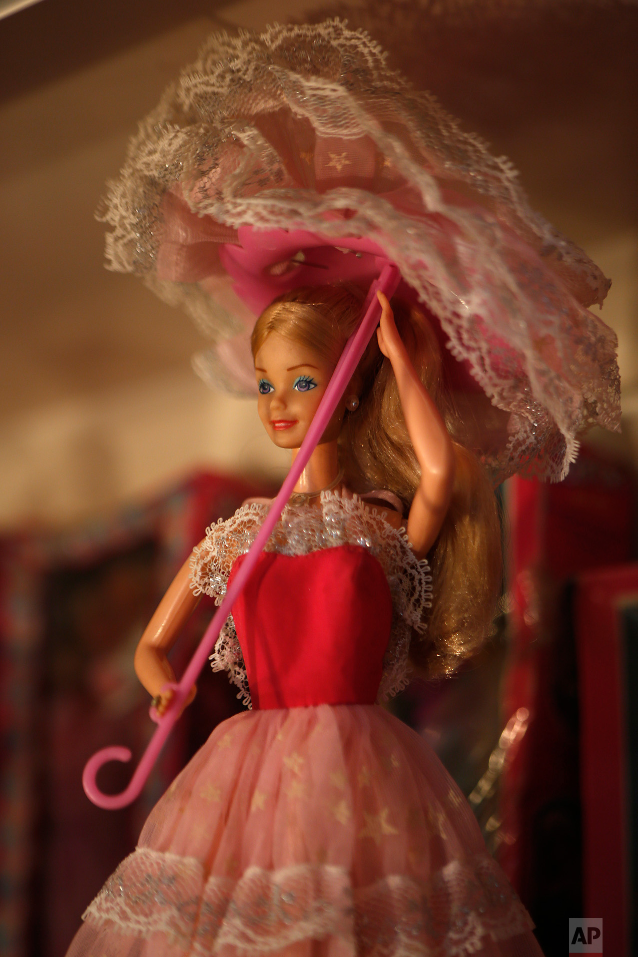 """In this Jan. 6, 2017 photo, a 1986 Barbie """"STAR Destello Magico"""" model made in Mexico, is displayed prior to the opening of a Barbie doll exhibit at the Mexico Antique Toy Museum in Mexico City. Among the millions of items displayed in this museum, all sorts of Mexican wrestling paraphernalia and old traditional Mexican toys remind Mexicans of their rich cultural heritage as well as a blunt reminder that before the North American Free trade agreement was signed in the 1990's, Mexico had a robust, healthy and creative national toy industry that is now practically defunct.(AP Photo/Dario Lopez-Mills)"""