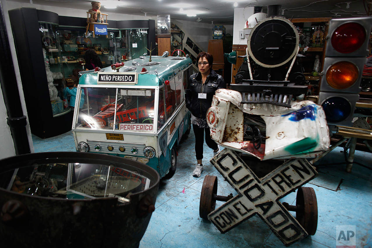 In this Jan.11, 2017 photo, visitors look at items displayed at the Mexico Antique Toy Museum in Mexico City. The Mexico Antique Toy Museum is a four story building filled with toys and objects that bring back childhood memories to the visitors that enter this unique monument to hoarding behavior. (AP Photo/Dario Lopez-Mills)