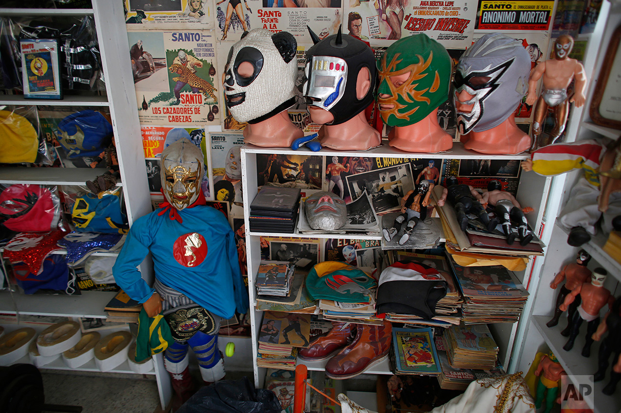 """In this Jan. 11, 2017 photo, Mexican """"lucha libre"""" wrestling masks and other paraphernalia are displayed in the Lucha Libre room of the Mexico Antique Toy Museum in Mexico City. The museum is having to struggle following a congressional decision to stop allocating cultural funds for the collection. The museum has had to cut staff by half and most of its cultural events and workshops have been suspended, says the son, who hopes to raise money for the museum through a Kickstarter campaign.(AP Photo/Dario Lopez-Mills)"""