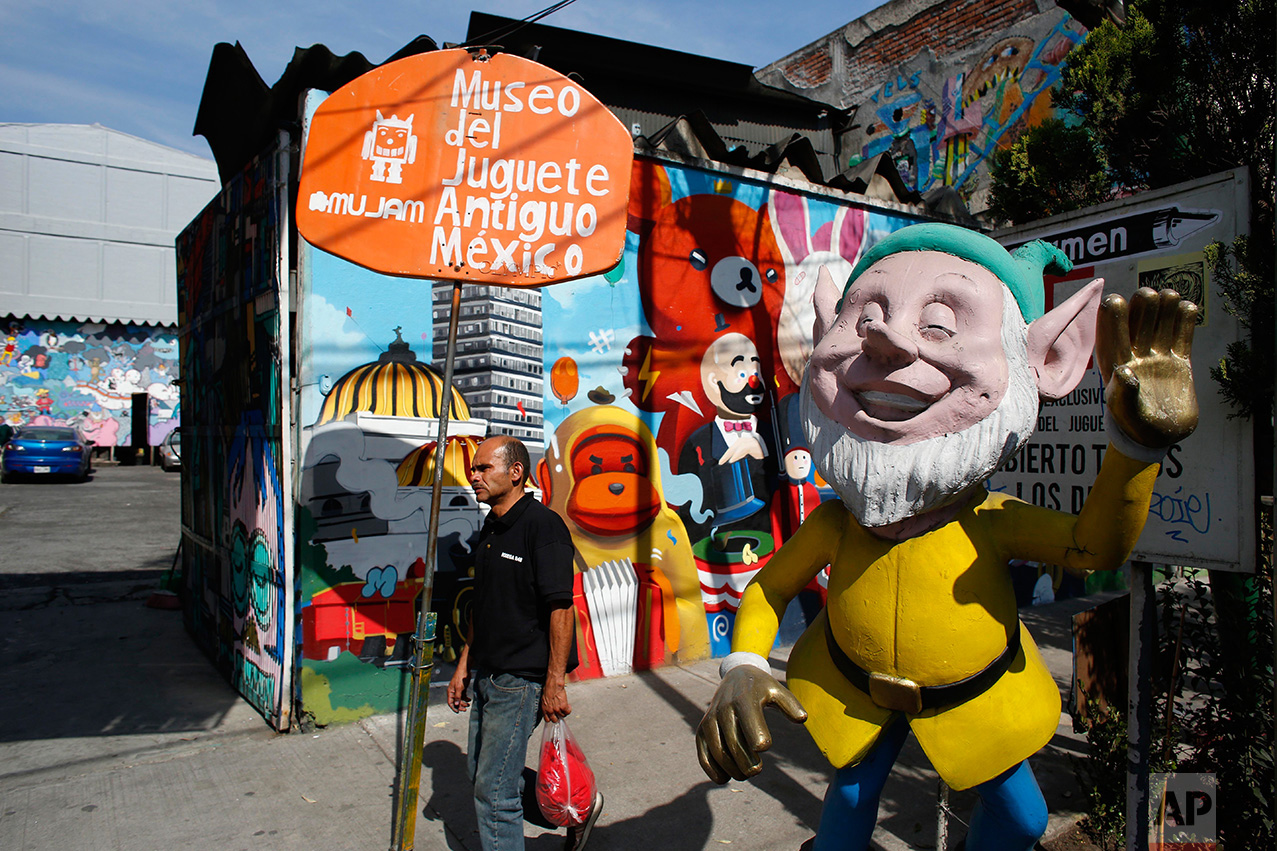 In this Jan. 11, 2017 photo, a man walks past the entrance to the Mexico Antique Toy Museum in Mexico City. The Mexico Antique Toy Museum is a four story building filled with toys and objects that bring back childhood memories to the visitors that enter this unique place. (AP Photo/Dario Lopez-Mills)