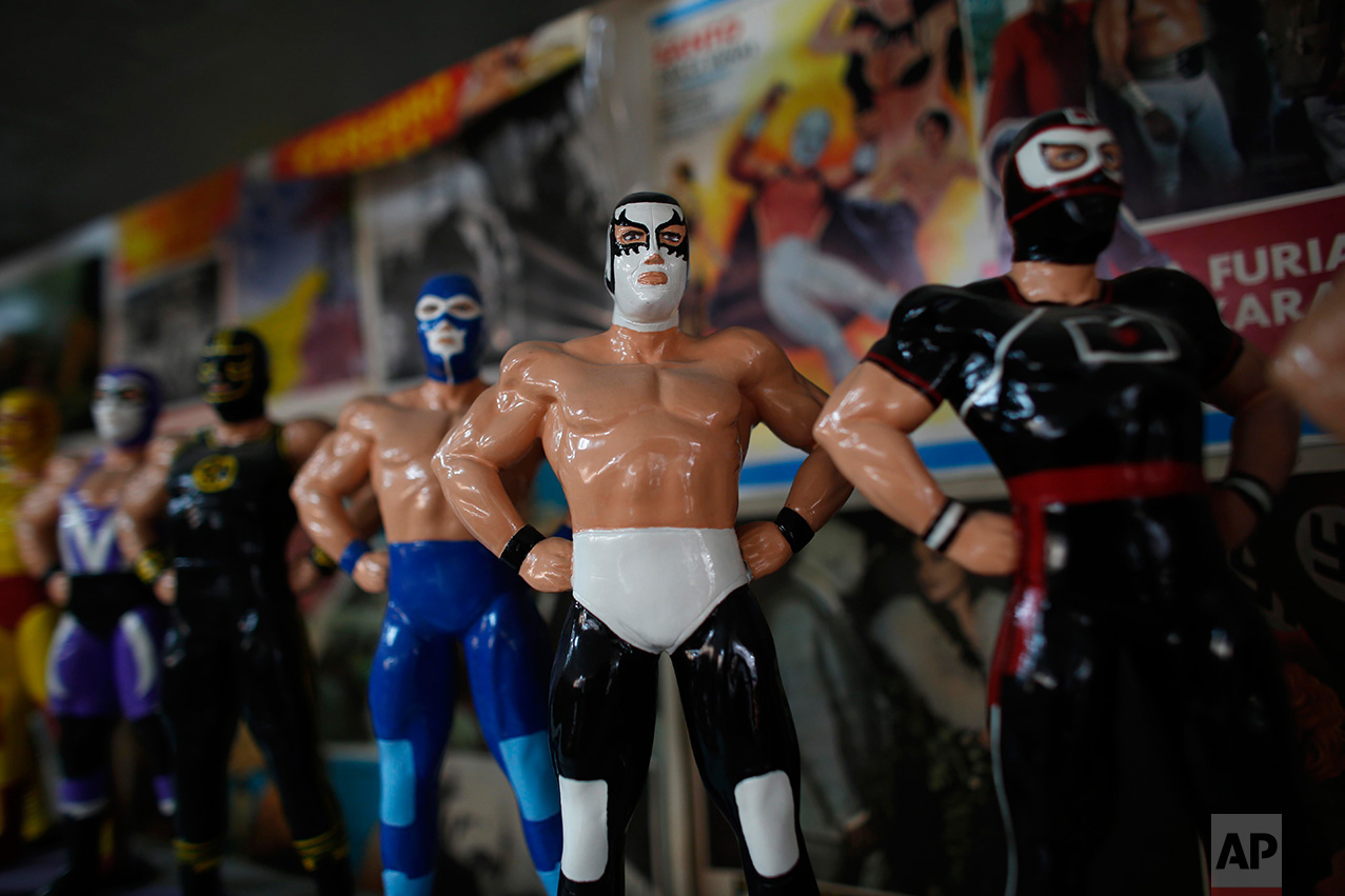 """In this Jan. 11, 2017 photo, Mexican """"lucha libre"""" wrestling dolls are displayed in the Lucha Libre room of the Mexico Antique Toy Museum in Mexico City. The museum is struggling, following a congressional decision to stop allocating cultural funds for the collection. The museum has had to cut staff by half and most of its cultural events and workshops have been suspended, but it hopes to raise money through a Kickstarter campaign. (AP Photo/Dario Lopez-Mills)"""