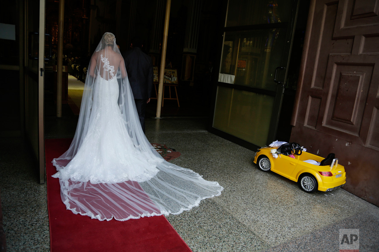 A bride waits for the procession to the altar at the San Jose or Altar de Oro church in the Casco Viejo neighborhood of Panama City on Saturday, Jan. 7, 2017. Casco Viejo is the old colonial district of Panama City, with cobblestone streets and colonial-era buildings. (AP Photo/Arnulfo Franco)