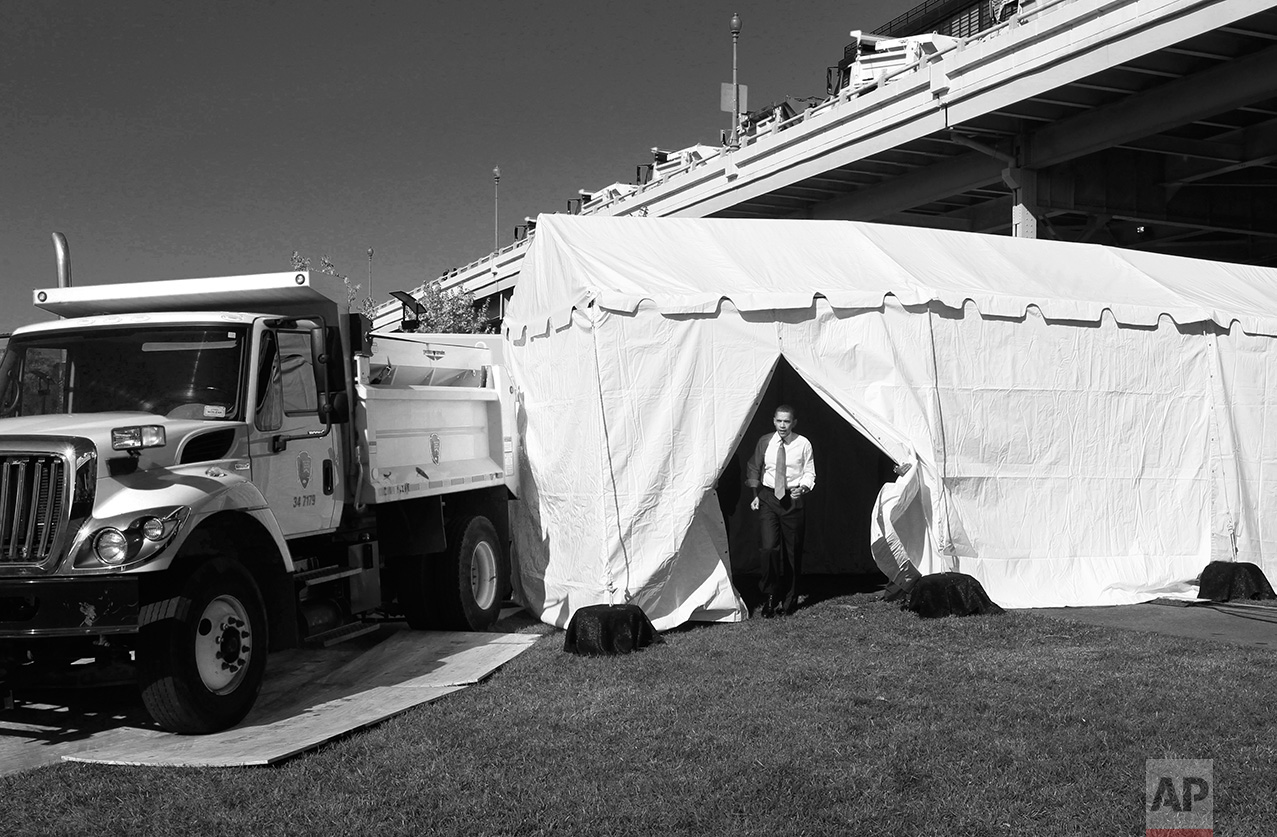 President Barack Obama emerges from a holding tent before speaking about jobs, Wednesday, Nov. 2, 2011, at Georgetown Waterfront Park in Washington. Obama is urging Congress to pass the infrastructure piece of the American Jobs Act. (AP Photo/Charles Dharapak)