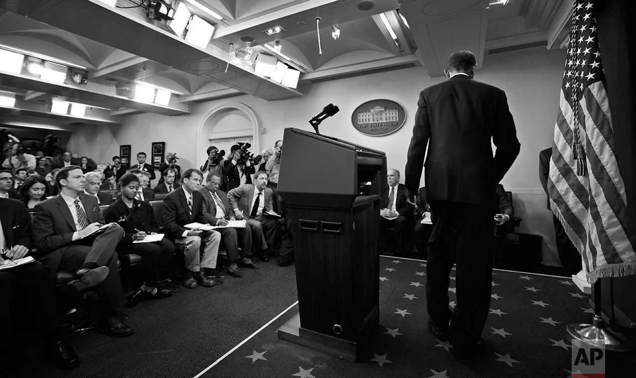 President Barack Obama leaves the podium after making a statement to reporters about the suspicious packages found on U.S. bound planes in the James Brady Press Briefing Room at the White House in Washington, Friday, Oct. 29, 2010. (AP Photo/Charles Dharapak)