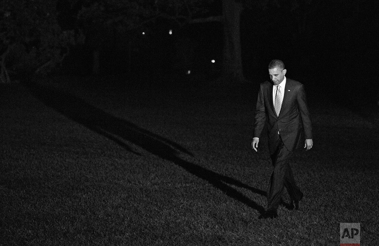 President Barack Obama walks on the South Lawn of the White House in Washington as he returns from a campaign event in Miami, Monday, Oct. 11, 2010. (AP Photo/Charles Dharapak)