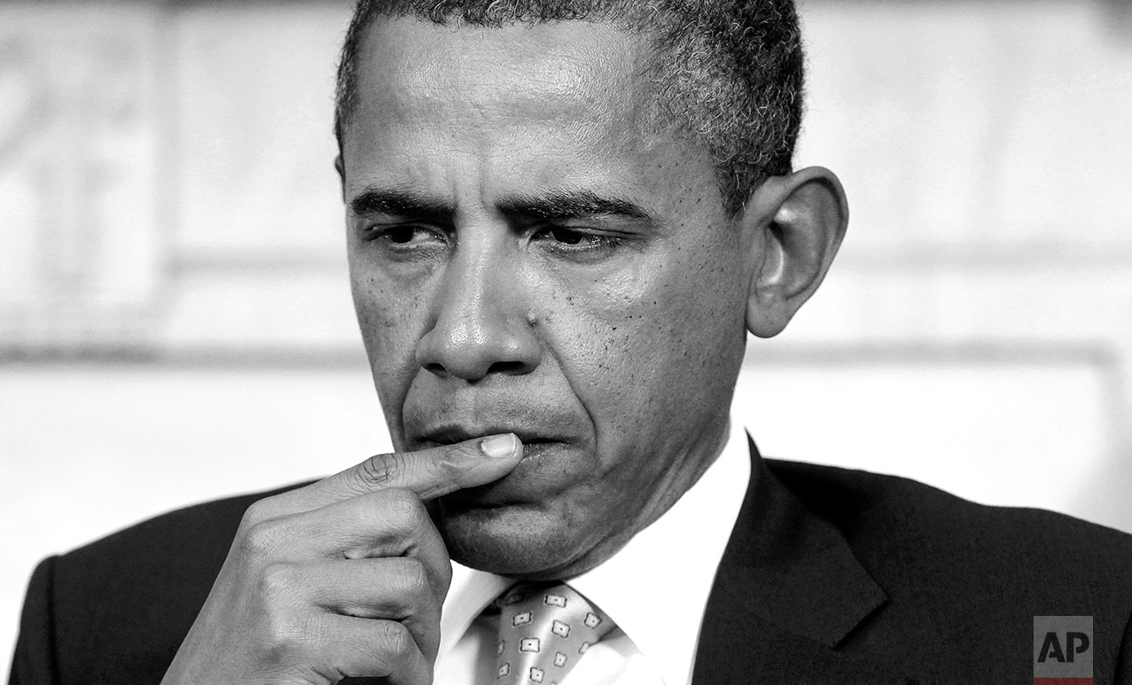 President Barack Obama is seated during a meeting in the Oval Office of the White House in Washington, Wednesday, Oct. 5, 2011. (AP Photo/Charles Dharapak)