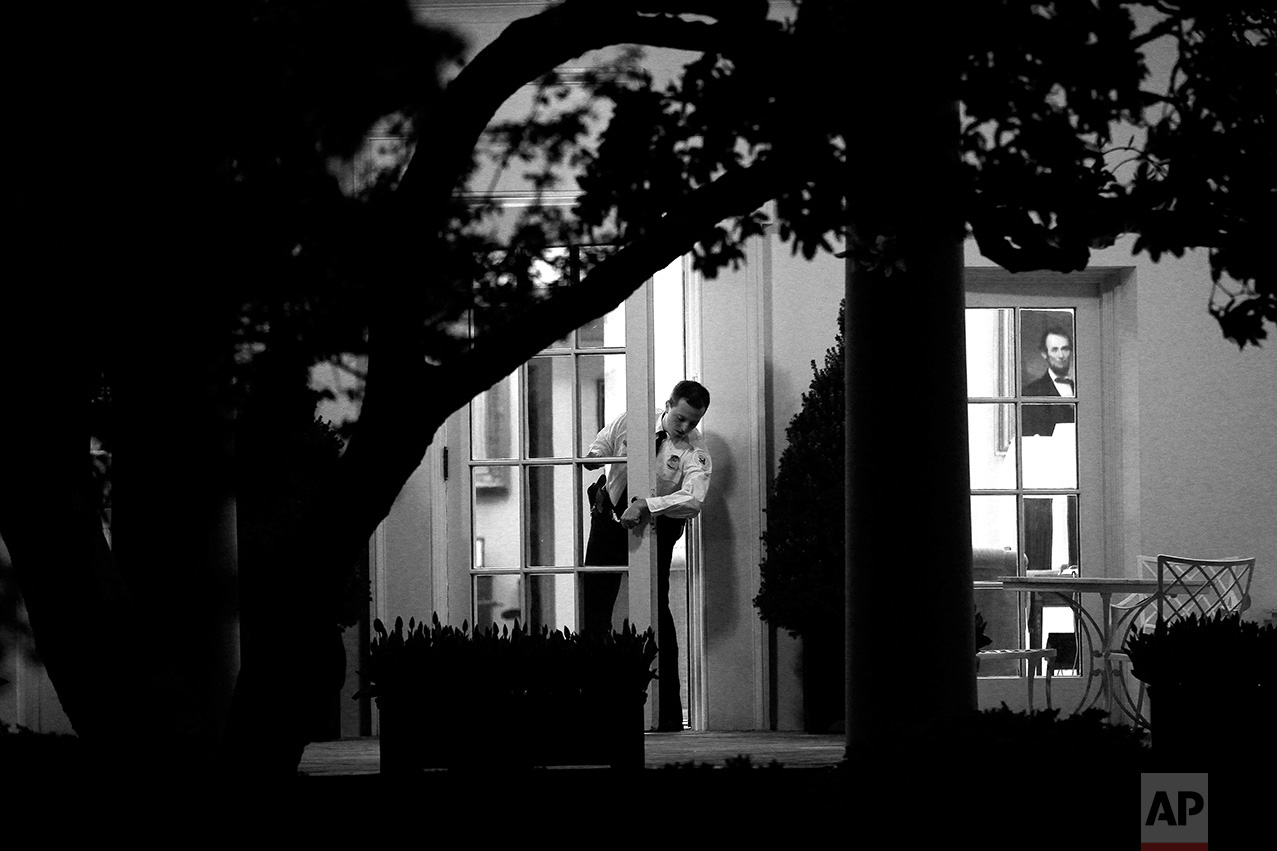 A Uniformed Division Secret Service officer checks the door to the Oval Office of the White House in Washington ahead of an evening meeting between President Barack Obama, House Speaker John Boehner, R- Ohio and Senate Majority Leader Harry Reid, D-Nev., regarding the budget and possible government shutdown, Wednesday, April 6, 2011. (AP Photo/Charles Dharapak)
