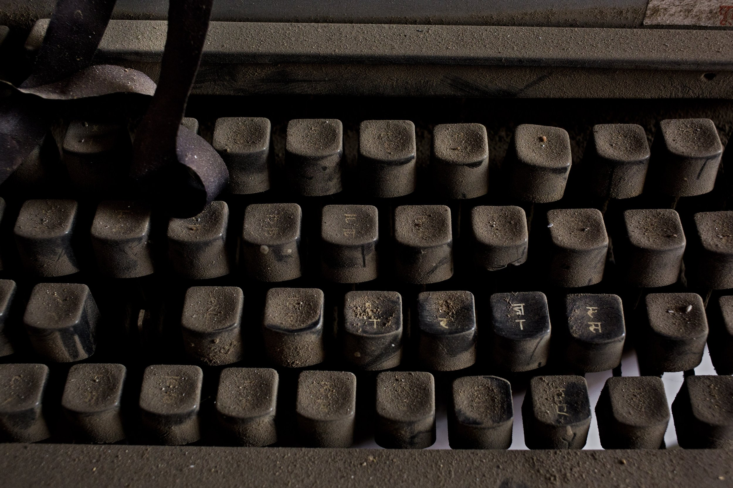 In this Jan. 16, 2017 photo, an old Remington 2000 typewriter lies covered in dust in New Delhi, India. In India, the typewriter was never just a piece of office equipment. It was a sign of education, of professional achievement, of women's growing independence as they slowly entered the workforce. But in one of the last places in the world where it remains a part of everyday life, twilight is at hand. (AP Photo/Bernat Armangue)