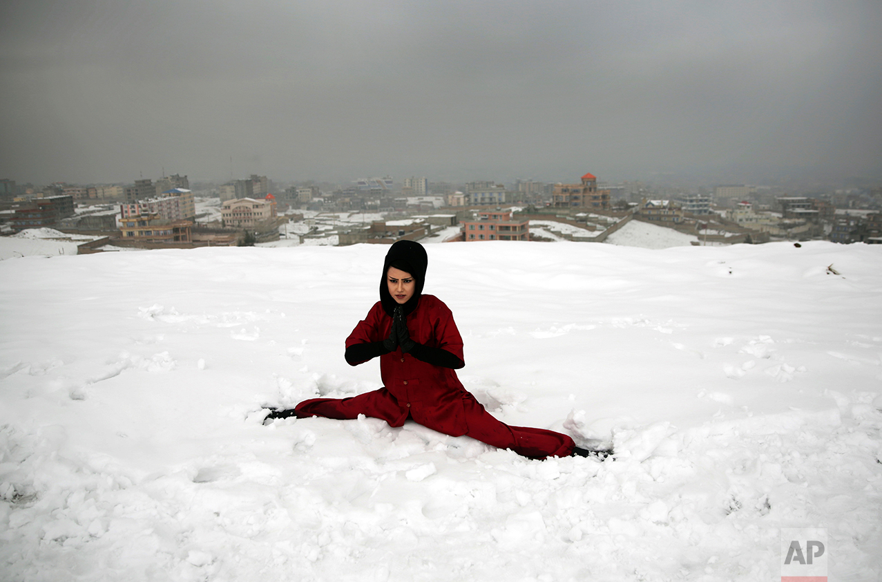 A Shaolin martial arts student practices the splits on a hilltop in Kabul, Afghanistan, Tuesday, Jan. 25, 2017. In religiously conservative Afghanistan, girls are often discouraged from aggressive sports. (AP Photos/Massoud Hossaini)