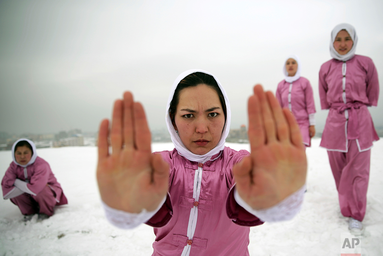 Shaolin martial arts students practice on a hilltop in Kabul, Afghanistan, Tuesday, Jan. 25, 2017. Teacher Sima Azimi, 20, not pictured, who is originally from Jaghuri in central Afghanistan, trains nine students in the martial arts to prepare for Olympic competitions, but also to protect themselves on the streets of Kabul, where women are routinely harassed. (AP Photos/Massoud Hossaini)