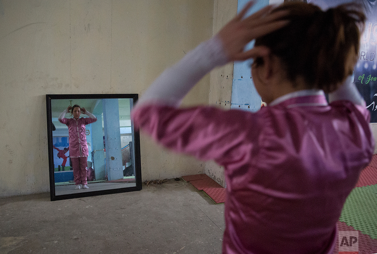 A Shaolin martial arts student prepares to practice at her club in Kabul, Afghanistan, Tuesday, Jan. 25, 2017. At first the women could not find Shaolin uniforms, but, undeterred, they designed and ordered uniforms made by a Kabul tailor. (AP Photos/Massoud Hossaini)