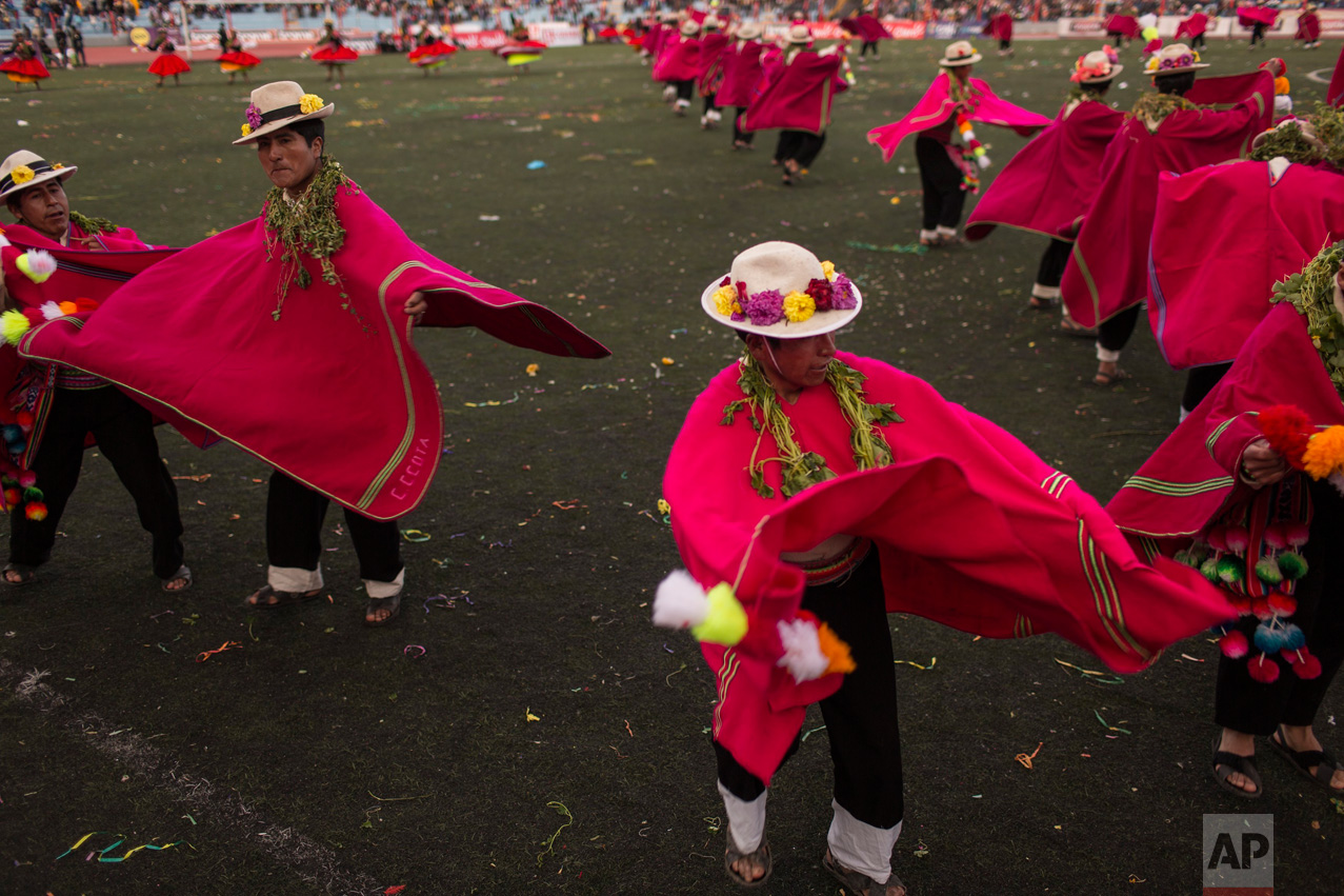 In this Jan. 29, 2017 photo, dancers perform during Virgin of Candelaria celebrations in Puno, Peru. Some dances gesture toward everyday village activities such as grazing llamas or shearing animals. Others depict the Spanish conquest or the conscription of villagers as soldiers. (AP Photo/Rodrigo Abd)