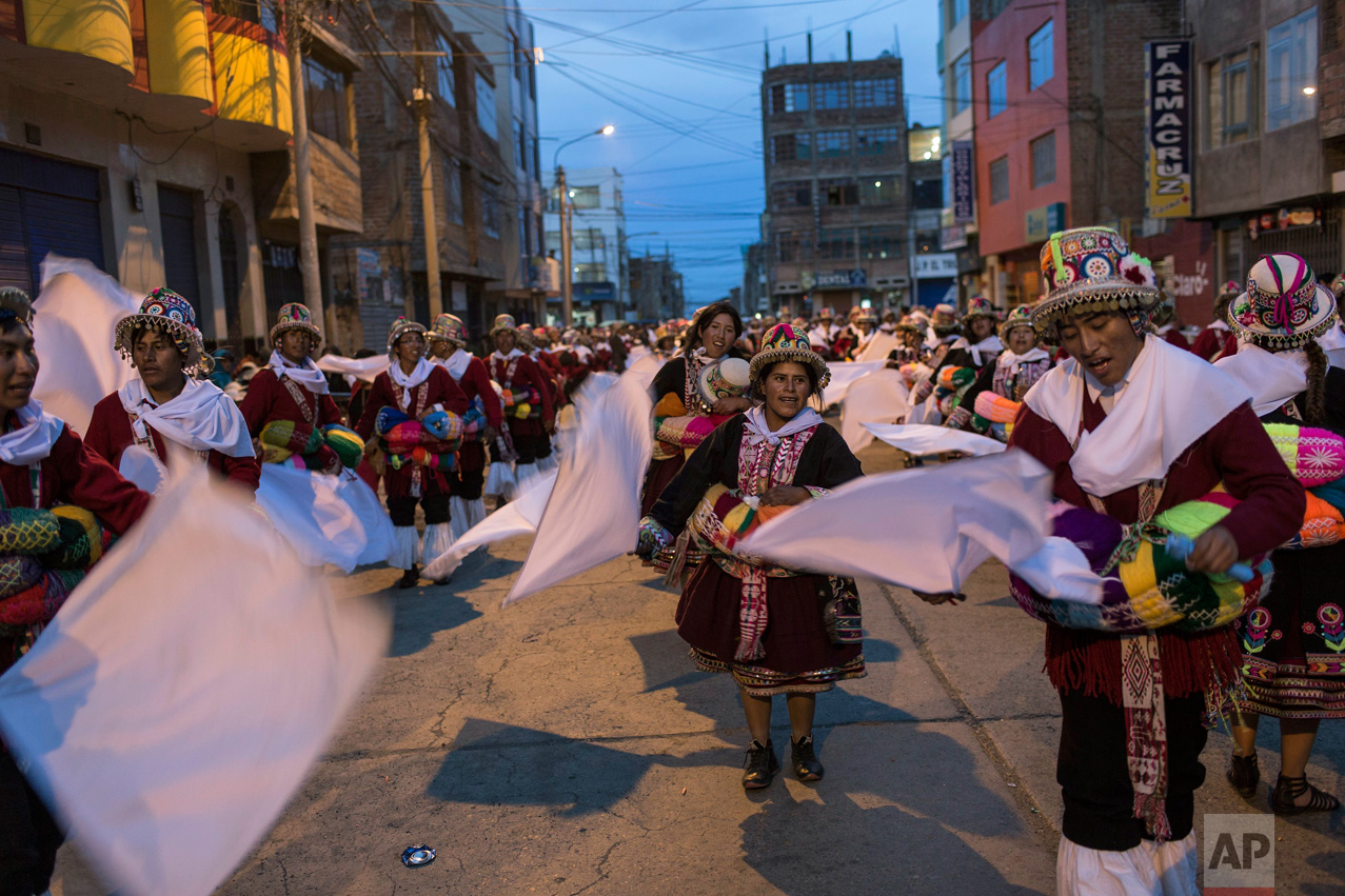 "In this Jan. 29, 2017 photo, dancers perform during Virgin of Candelaria celebrations in downtown Puno, Peru. ""We have danced this way since the time of our grandparents,"" said 75 year-old Martin Mamani, who made the trek from the village of Esmeralda. (AP Photo/Rodrigo Abd)"
