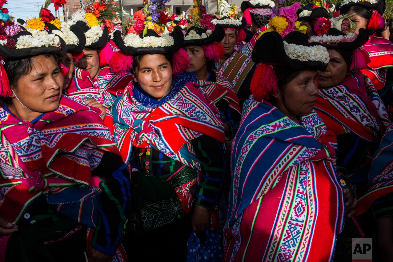 In this Jan. 29, 2017 photo, dancers wait their turn to perform during Virgin of Candelaria celebrations in Puno, Peru. In addition to devotion, villagers have other reasons for dancing on the feast. Some are grateful to have been cured of disease, while others are asking for protection for their crops, or increased political power. (AP Photo/Rodrigo Abd)