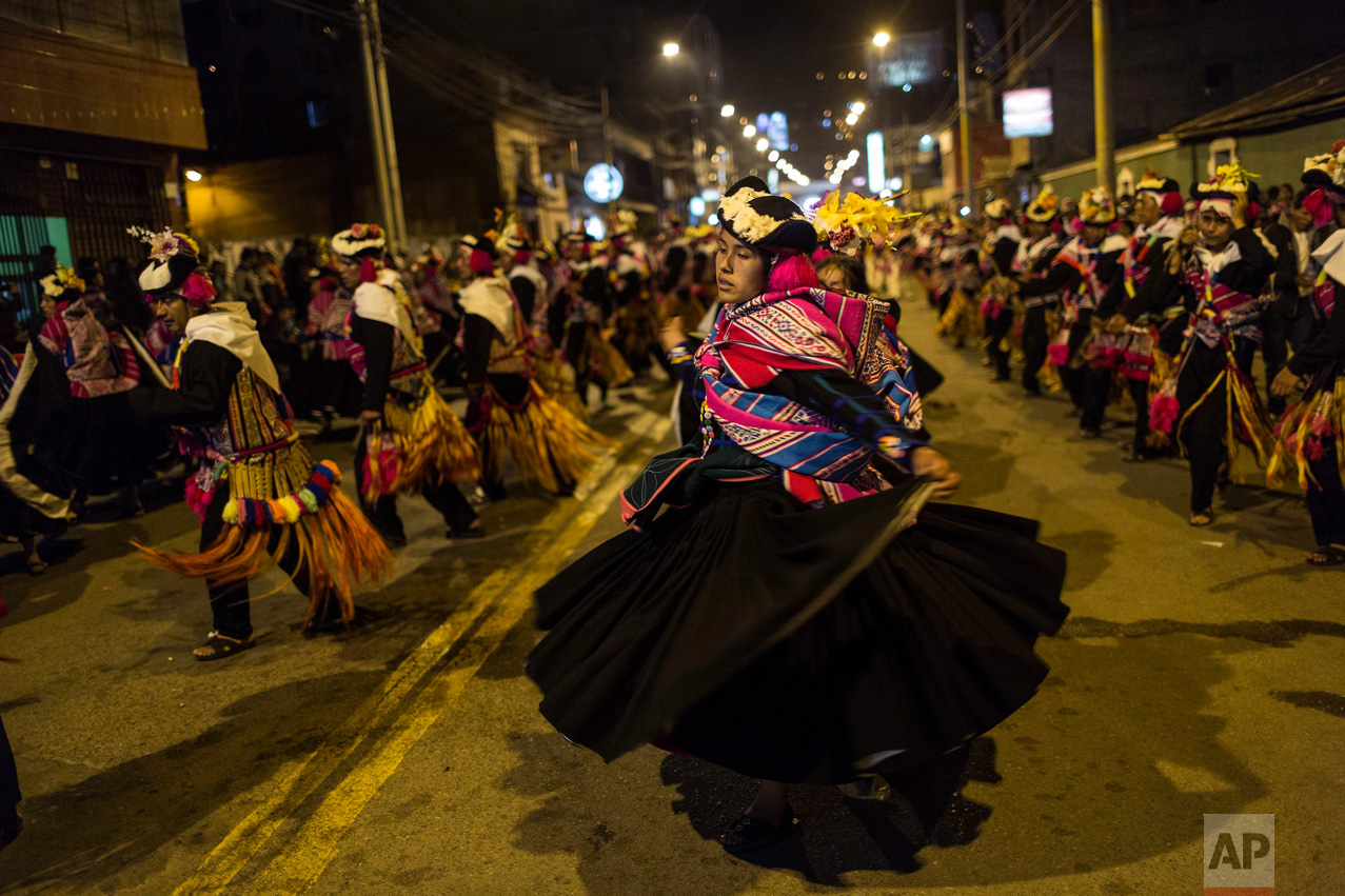 In this Jan. 29, 2017 photo, dancers perform during Virgin of Candelaria celebrations in downtown Puno, Peru. The annual celebration is a rare moment of national focus on an indigenous-dominated village culture in Peru. (AP Photo/Rodrigo Abd)