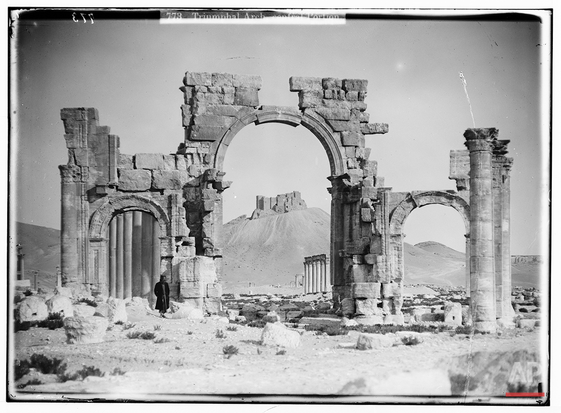 In this undated photo, believed to have been made between 1900 – 1920, the Triumphal Arch's central portion is shown in the ancient city of Palmyra in the central Homs province, Syria. (Library of Congress via AP)