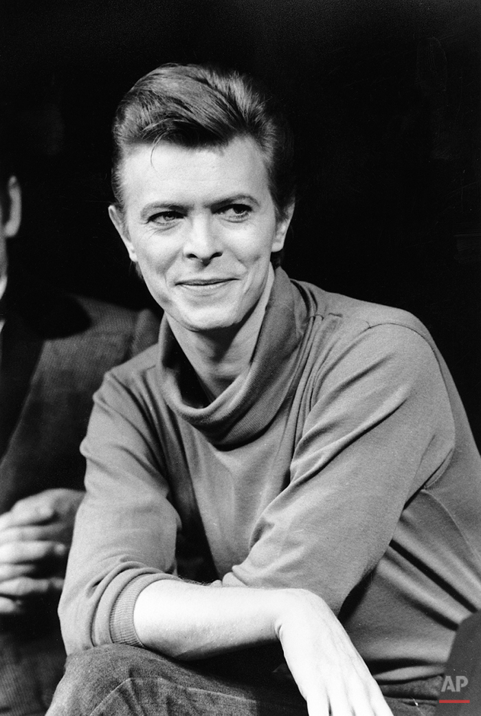 """In this Sept. 17, 1980 photo, David Bowie listens during a news conference after a rehearsal at the Booth Theater in New York. Bowie was appearing in the Broadway production of """"The Elephant Man."""" Bowie, the innovative and iconic singer whose illustrious career lasted five decades, died Monday, Jan. 11, 2016, after battling cancer for 18 months. He was 69. (AP Photo/Marty Lederhandler)"""
