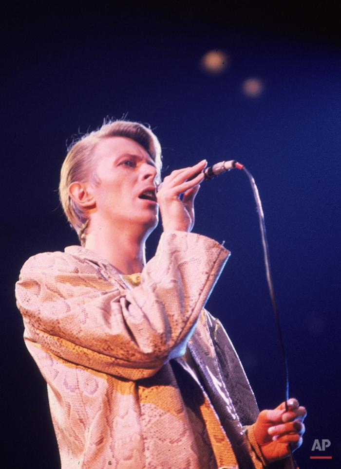 British rock singer, David Bowie, shown performing at a New York concert in May 1978. (AP Photo/Brian Killigrew)