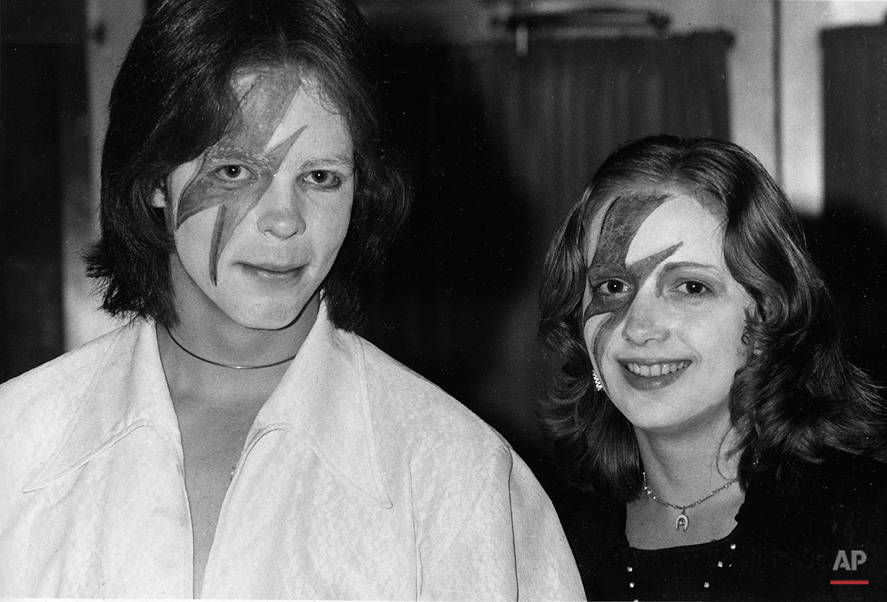 Two fans of glitter-rock singing star David Bowie wears makeup at Bowie's weekend concert at New York's Radio City Music Hall, Nov. 3, 1974. (AP Photo/Suzanne Vlamis)