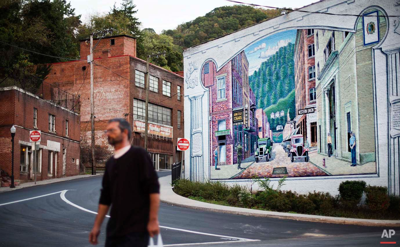 A mural depicting a more vibrant time in the town's history decorates a building in the business district, Tuesday, Oct. 6, 2015, in Welch, W.Va. Poverty experts say these efforts helped relieve the most acute conditions, but did little else. As coal employment declined, people fled because there was little else for them to do. McDowell County, home to Welch, had a population of just under 100,000 in 1950. Since then, the county???s population has fallen by four-fifths, to around 20,000. (AP Photo/David Goldman)