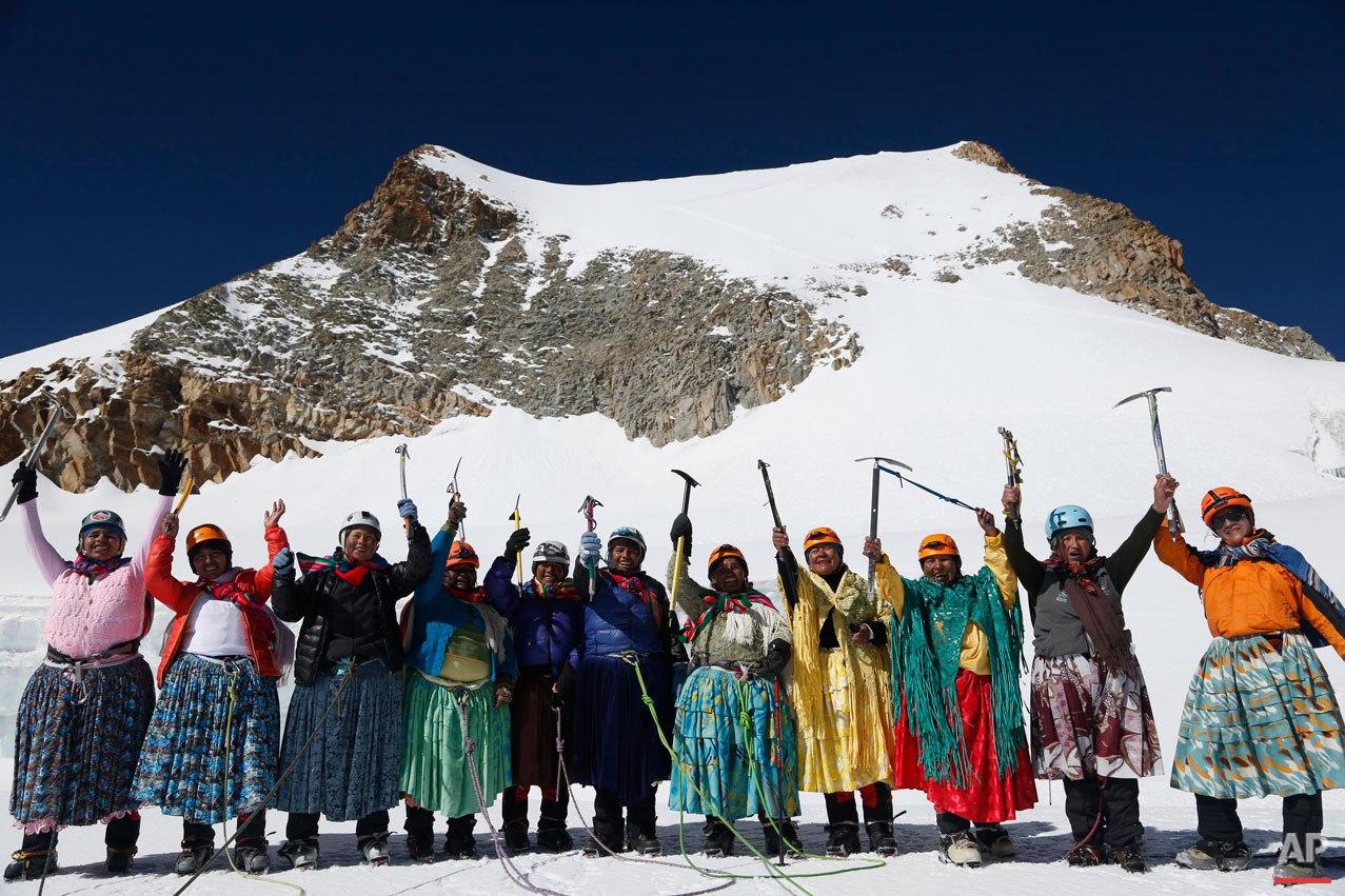In this Dec. 16, 2015 photo, Aymara indigenous women pose for a picture as they reach the peak of the Huayna Potosi mountain on the outskirts of El Alto, Bolivia. From left are Cecilia Llusco, Juana Rufina Llusco Alana, Janet Mamani Callisaya, Domitila Alana Llusco, Marga Alana Llusco, Virginia Quispe Colque, Pacesa Llusco Alana, Lidia Huayllas, Bertha Vetia, Dora Magueno and Ana Gonzales. (AP Photo/Juan Karita)